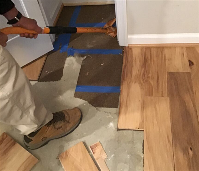 man removing wood floor