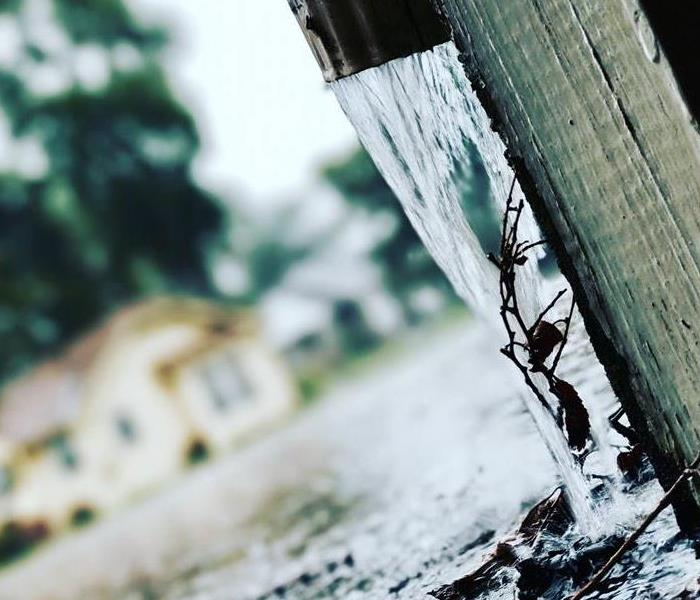 rain water coming out of gutter